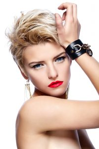 High fashion look.glamor closeup portrait of beautiful sexy blond Caucasian young woman model with red lips,bright makeup, with short hair with perfect clean skin isolated white